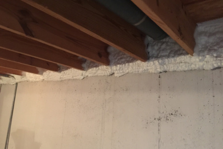 This picture demonstrates how your basement seal boxes look after we apply spray foam insulation in Glencoe IL.