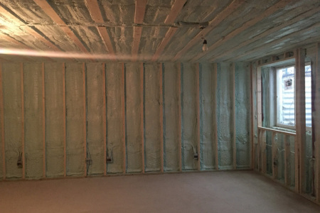Winfield IL basement insulated with closed cell spray foam insulation to save energy.
