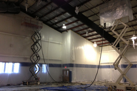 This is two Revfoam team members in action applying Open cell spray foam Insulation on the ceiling.