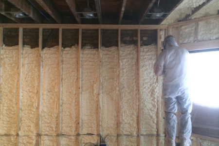 Apartments are also a great opportunity to isolate with Spray Foam.  Here you see our team members spraying open cell insulation on the exterior walls in Wilmette IL.